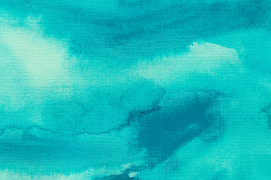 Turquoise splash watercolor texture background. Hand drawn vivid gradient backdrop.