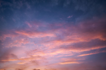 cloudscape at dusk with red clouds