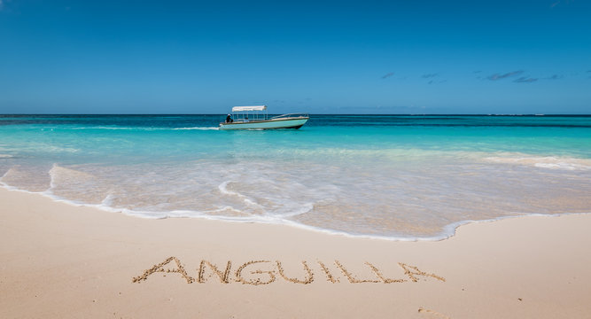 Beautiful tropical beach. Anguilla written in white sand.