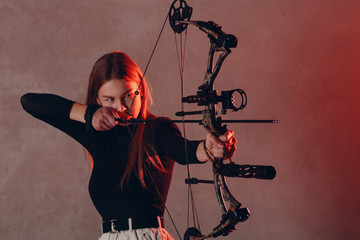Archer woman with modern block sport olympic bow and arrow