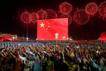 Fireworks explode over Tiananmen Square as performers take part in the evening gala marking the 70th founding anniversary of People's Republic of China