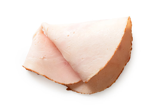 A folded single slice of chicken ham isolated on white. Top view.