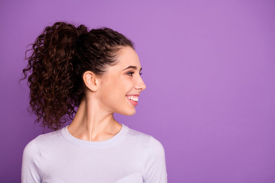Close-up profile side view portrait of her she nice attractive cheerful cheery glad wavy-haired girl wearing white t-shirt looking aside isolated over violet lilac purple pastel color background