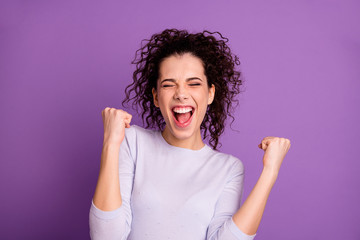 Close up photo of amazing wavy lady win competition yelling raising fists celebrating wear casual pullover isolated purple color background