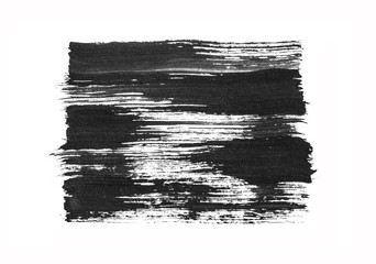 Black abstract hand painted brush strokes isolated on white background.