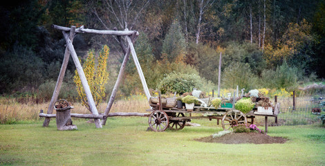 Aluminium Prints Gray Panoramic autumn landscape with old wagon