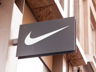 New York, New York, USA - September 26, 2019: A Nike swoosh sign on Broadway in Soho.