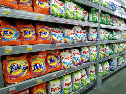 KEMEROVO, RUSSIA, FEBRUARY 14, 2019. Shelves with various laundry powder in a hypermarket Lenta