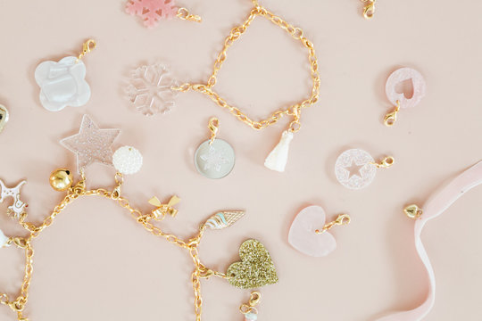 Girls christmas present 24 days of jewelry necklace and bracelet charms in gold tins
