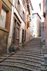 alley in the old town of Le Puy En Velay in the Auvergne region in the center of France