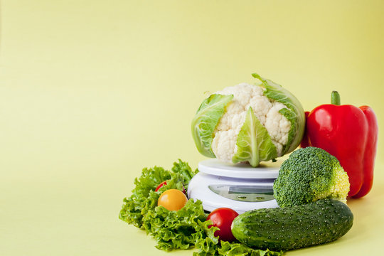Fresh vegetables on vase on yellow background. Healthy eating, diet planning, weight loss, detox, organic farming concept