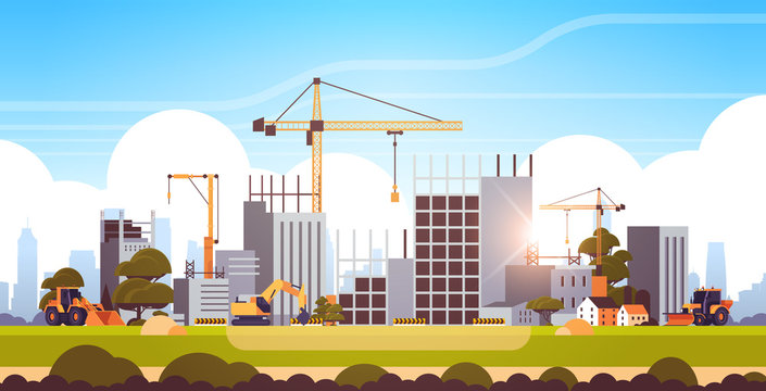 modern construction site with cranes tractor and bulldozer unfinished building exterior sunset background flat horizontal