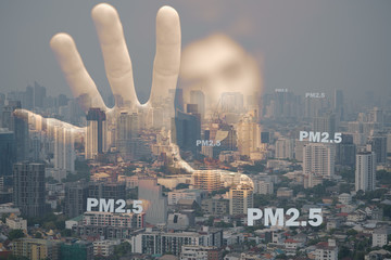Double exposure of human hand and blurry face with fog cityscape that have dirty air pm2.5 pollution, Concept of air pollution city in crisis danger environment, pm2.5 is cause of illness cancer.
