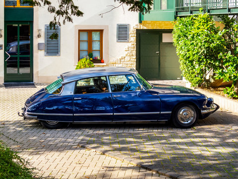 Beautiful shiny dark blue old Citroen DS 21 Pallas from 1965 in Vianden, Luxembourg, , side view