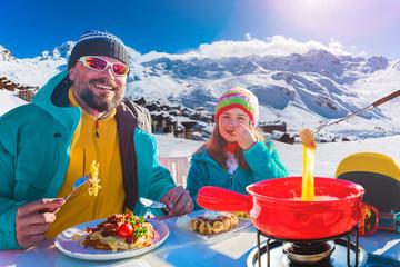Fototapete - Ski restaurant lunch break with Fondue cheese, mountain view of Val Thorens, 3 valleys , France.