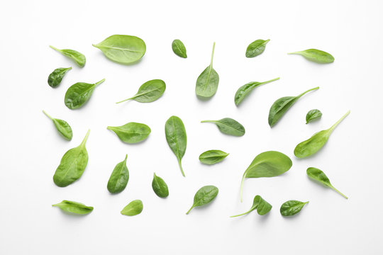 Fresh green healthy spinach leaves on white background, top view