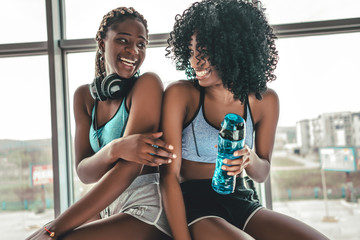 Happy healthy young African American woman working out in a gym Wall mural