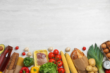 Fresh vegetables and other products on light grey background, flat lay. Space for text - fototapety na wymiar