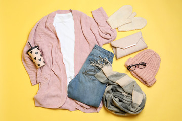 Fototapete - Flat lay composition with winter clothes and glasses on yellow background