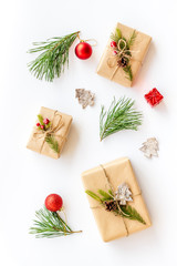 Winter festive layout with spruce branches and New Year presents on white background top view flat lay