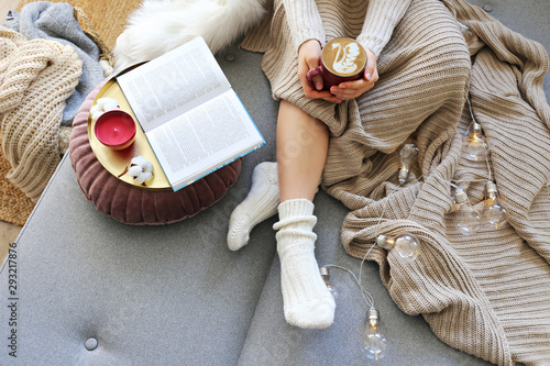 Magnificent Top View Of Woman Relaxing On Couch At Home Drinking Latte Dailytribune Chair Design For Home Dailytribuneorg