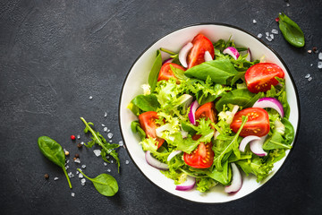 Green salad from leaves and tomatoes.