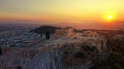 Aerial photo of iconic Masterpiece of Ancient world, Acropolis and the Parthenon at sunset with beautiful golden colours, Athens, Attica, Greece