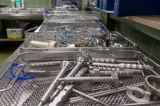 in a sterilization department in a hospital are many instrument trays that still need to be packed