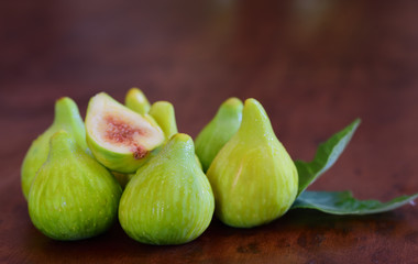 Closeup of green fresh figs on a wooden table