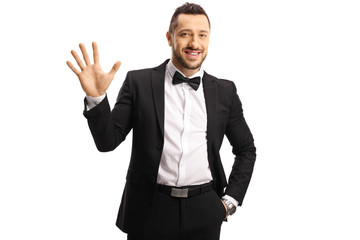 Young man in a suit showing five fingers on hand