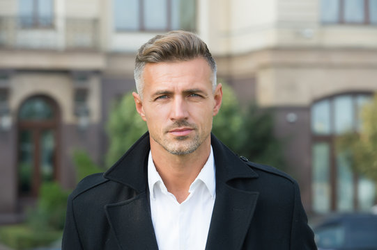 Facial care and ageing. Beauty of mature face. Traits and behaviors that make men more appealing. Attractive mature man. Mature guy with grey hair and bristle. Men get more attractive with age
