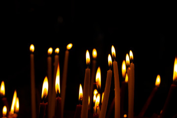 candle illumination on black background religion concept picture in pray time, empty copy space for text