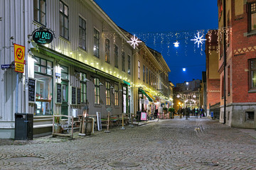 Pedestrian street Haga Nygata with well-preserved wooden houses of 19th century in Christmas illumination on December 16, 2015 in Gothenburg, Sweden
