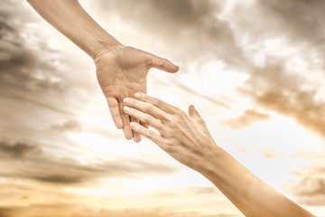 Hand reaching out to help another. Helping a friend in need.