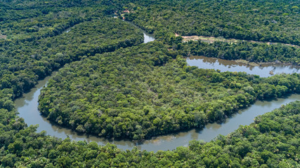 Aerial view of a meandering Amazon tributary river, Amazonian rainforest, San Jose do Rio Claro, Mato Grosso