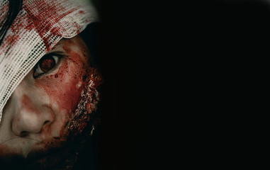 Close-up zombie women looks at her with resentment in an abandoned building, Halloween murder concept.