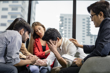 Group problematic young people talking with a guidance counselor.