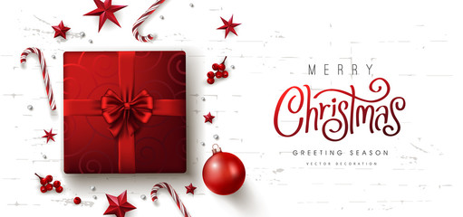 Wall Mural - Christmas red Decorative Border made of Festive Elements Background .Merry Christmas vector text Calligraphic Lettering Vector illustration.Presents on white background top view.