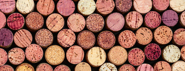 Wine corks Pattern. Various wooden wine corks as a Background. Food and drink concept .
