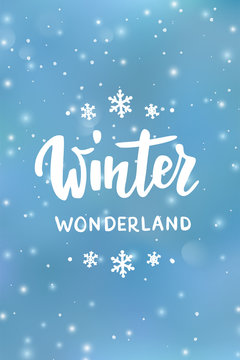 Winter wonderland text, hand drawn brush lettering. Holiday greetings quote. Blue background with falling snow effect.