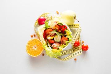 plate with fresh diet vegetables and fruits slimming food concept