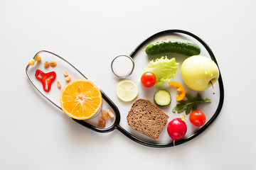 fresh fruits and vegetables and stethoscope healthy eating concept