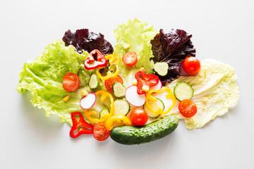 sliced vegetables on lettuce concept vegetarian food, diet