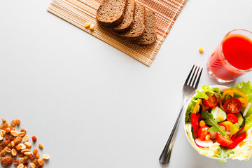 fresh vegetables and nuts with tomato juice - diet food on a white background with place for text