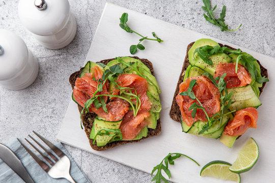 toast with dark rye bread, avocado, smoked salmon and cucumber