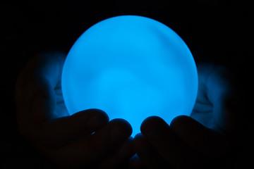 Shining magic ball in hands