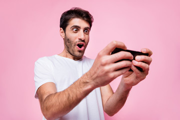 Portrait of funky funny arabian multiethnic guy use his cellphone find new video game play addicted player have fun wear style clothes isolated over pastel color background