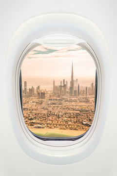 Dubai seen through the window of airplane, travel in UAE concept