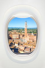 Wall Mural - Siena seen through the window of airplane, travel in Europe concept