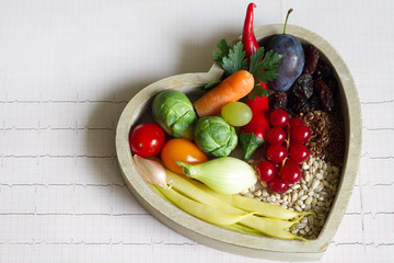Healthy food in heart and cardiogram diet concept